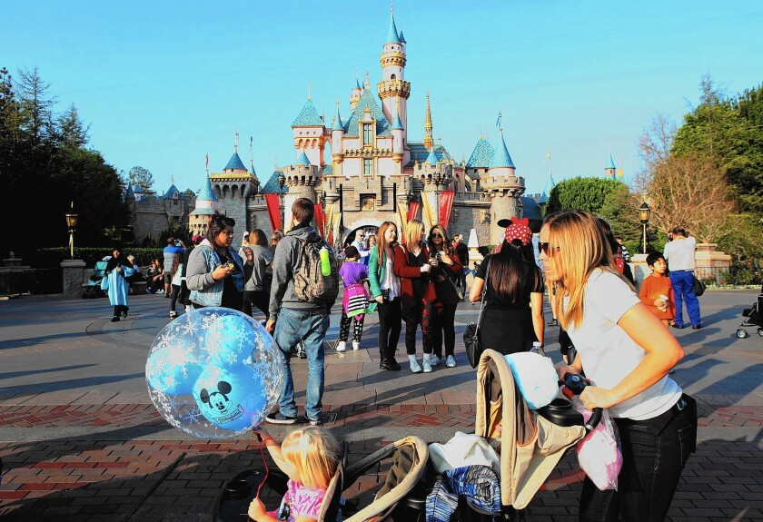 Disneyland guests enjoy a day at the park. A person ill with measles who was at the park triggered an outbreak that has infected 26 people in four states.