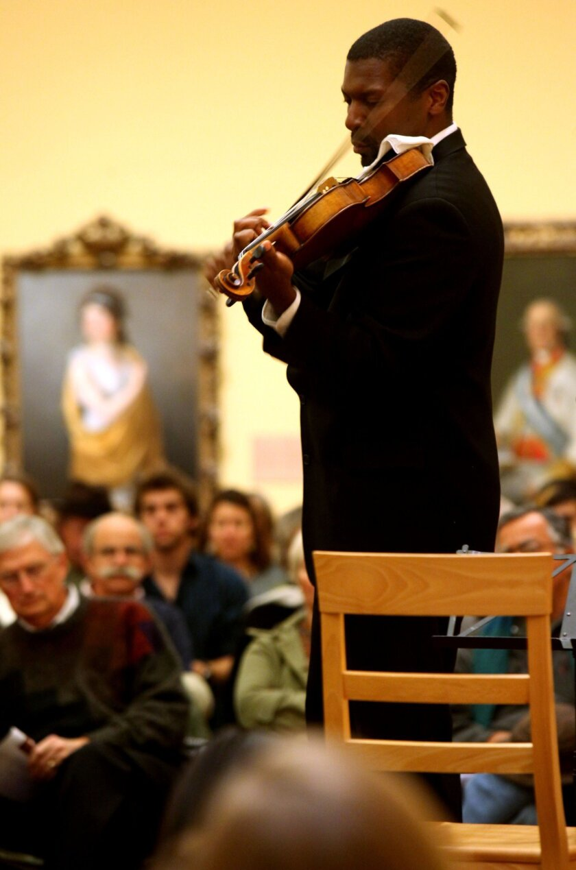 Amadi Azikiwe performs on the Viola during a performance from the Art of Elan at the San Diego Museum of Art in Balboa Park on Tuesday, November 30, 2010.