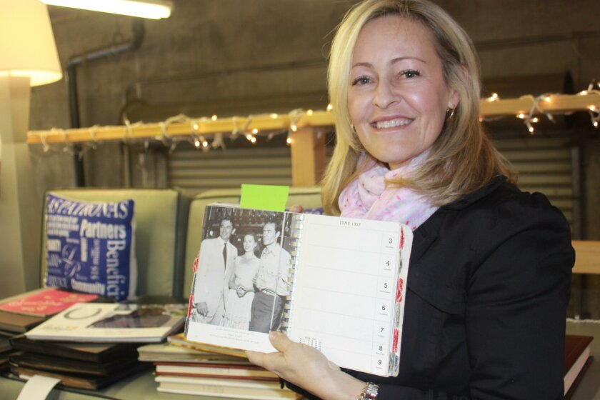 2016 Jewel Ball chair Kathryn Gayner holds a program book from the 10th Jewel Ball in 1956 — when actor Gregory Peck was in attendance.