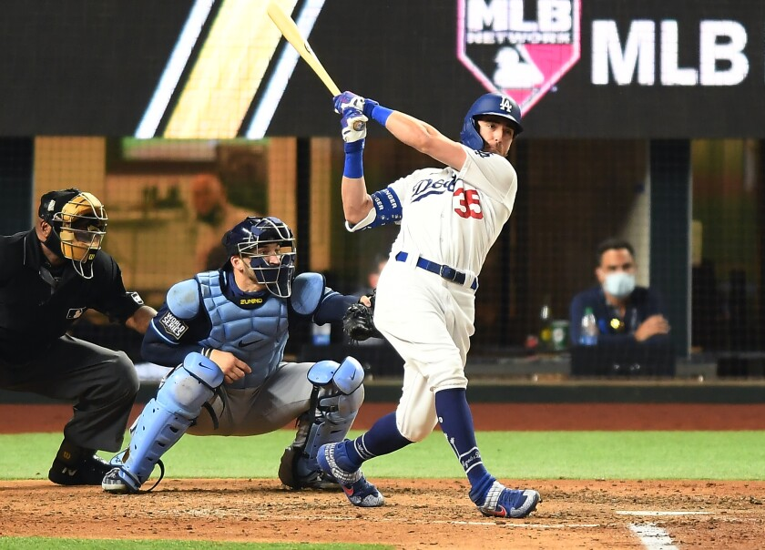 Cody Bellinger follows through on a swing that brought him a home run.