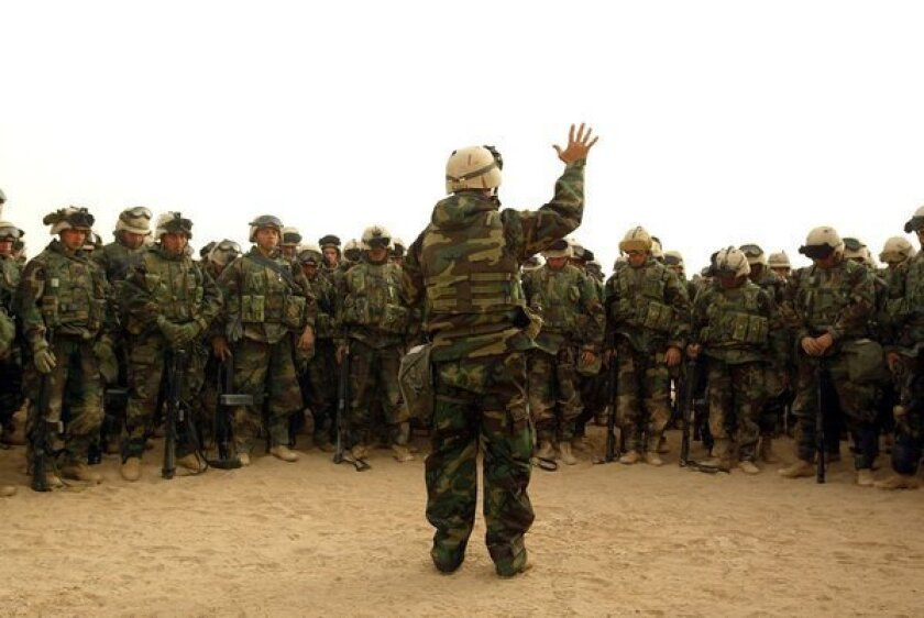 A U.S. Navy chaplain in Kuwait leads Marines in prayer before they head off to battle in Iraq in March 2003. Jason Heap says he wants to serve those sailors who don't believe in God.