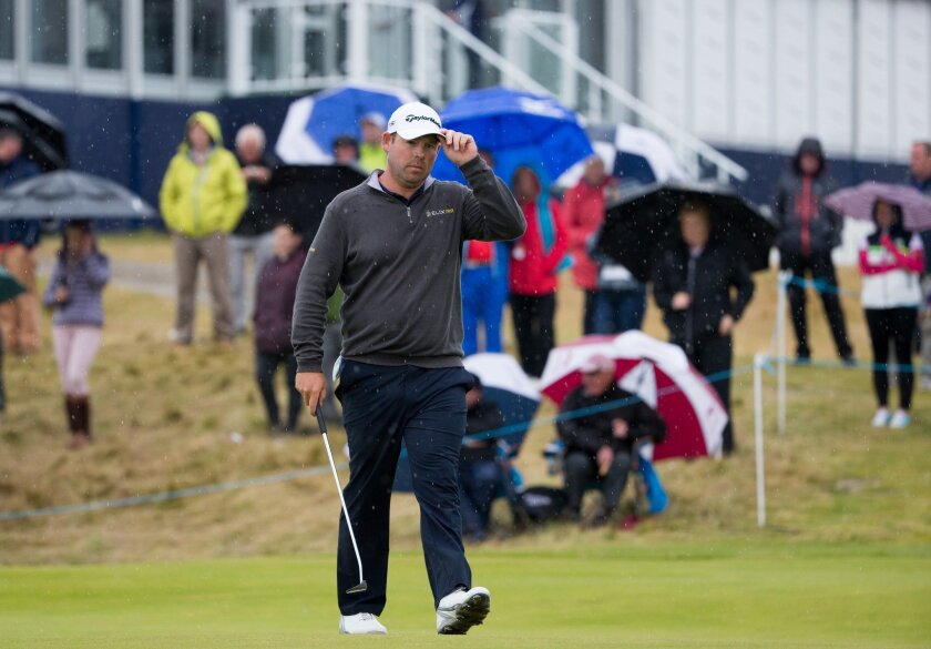 South Africa's Justin Walters acknowledges fans on the 18th green during day three of the 2016 AAM Scottish Open golf championship at Castle Stuart Golf Links in Inverness, Scotland, Saturday July 9, 2016. (Kenny Smith / PA via AP)