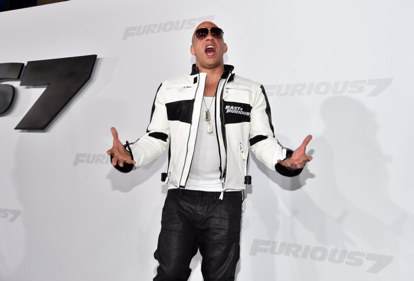 "Action star Vin Diesel in ""Fast & Furious"" attire."