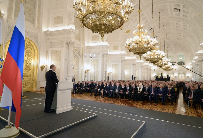 Russian President Vladimir Putin delivers his annual state of the nation address at the Kremlin in Moscow on Thursday.