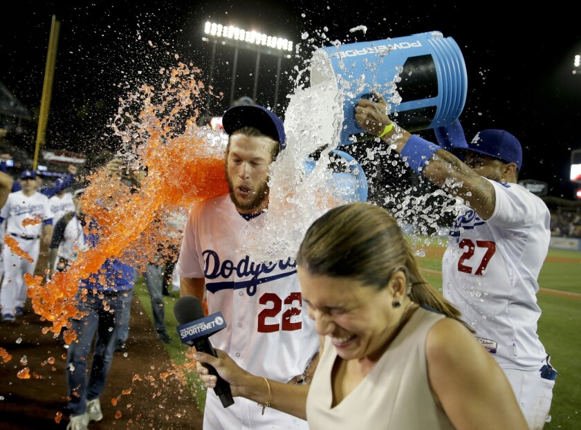 Teammates give Clayton Kershaw a celebratory Gatorade bath as he's interviewed after pitching a no-hitter against the Rockies on Wednesday night at Dodger Stadium.