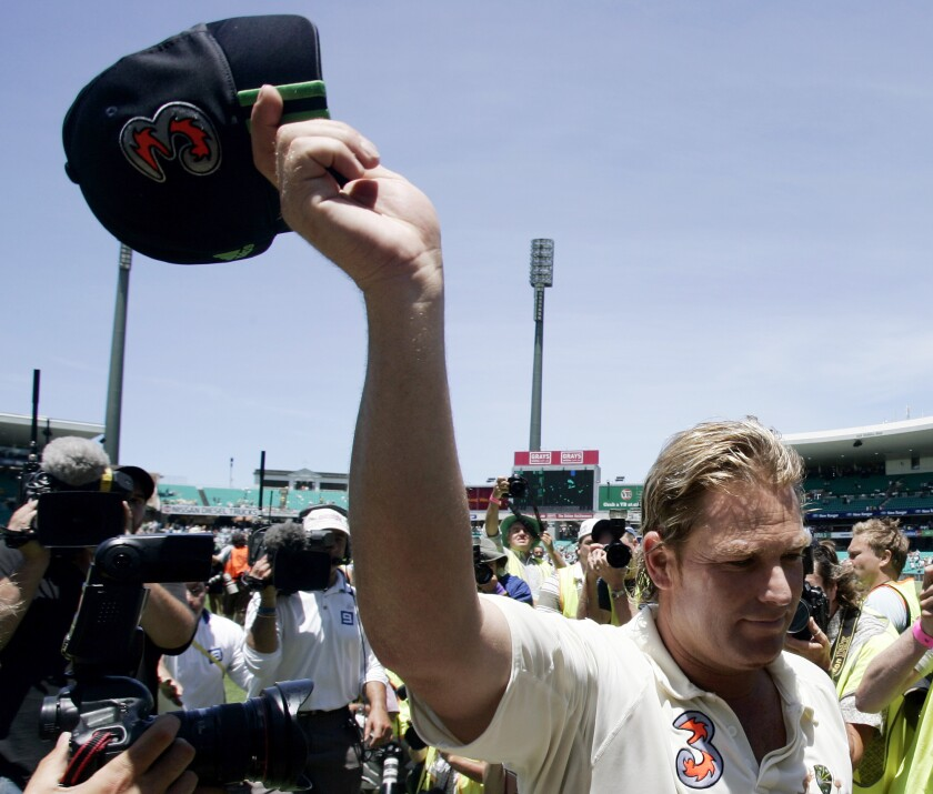 FILE - In this Jan. 5, 2007 file photo, Australian bowler Shane Warne waves his cap to the crowd as he leaves the field following their win over of England in the fifth and final Ashes cricket test in Sydney, Australia. Warne's baggy green cap has made more than 1 million Australian dollars, or 685,000 US dollars, at auction to aid those affected by wild fires across the country. When bidding closed on Friday morning the famous cap which is given to each Australian test cricketer was sold for $1,007,500. (AP Photo/Mark Baker,File)