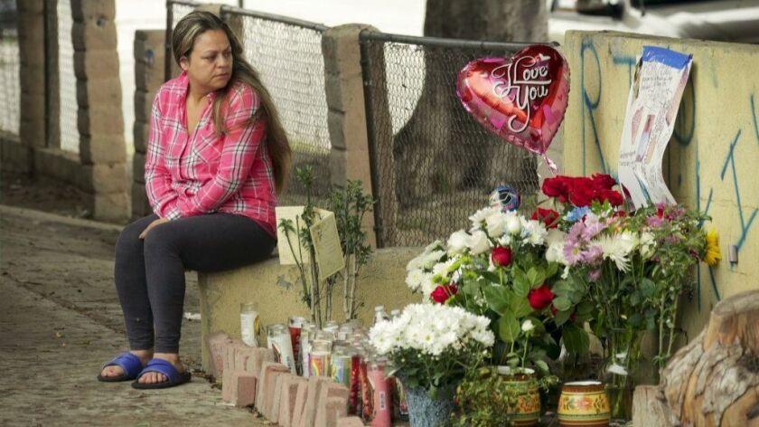 WILMINGTON CA JUNE 07, 2017 --- Ana Leticia Rodriguez at make-shift memorial mourns the shooting dea