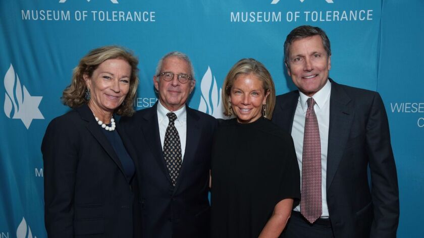 From left, Gretchen Hoadley, honoree Ron Meyer, Kelly Meyer and Steve Burke, NBCUniversal president