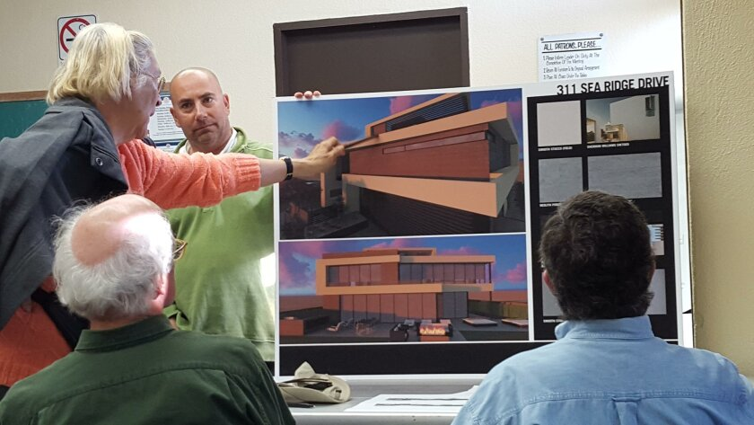 Project developer David Lesnick shows DPR members a rendering of the proposed Sea Ridge Drive project.