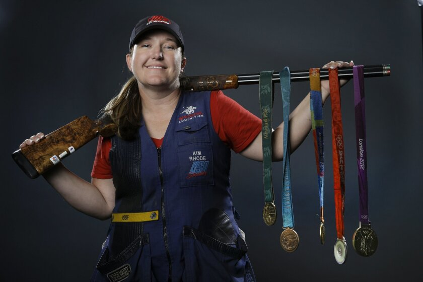 FILE - In this March 8, 2016, file photo, double trap and skeet shooter Kim Rhode poses for photos with her Olympic medals at the 2016 Team USA media summit in Beverly Hills, Calif. Misfortune stacked up like spent shotgun shells in the four years since Kim Rhode won her third Olympic gold medal. (AP Photo/Jae C. Hong, File)