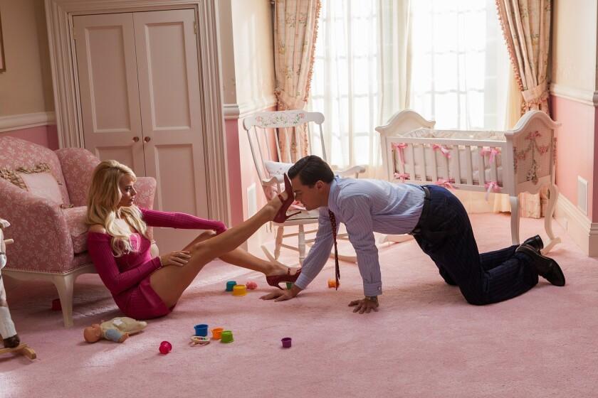 "Margot Robbie as Naomi Lapaglia and Leonardo DiCaprio as Jordan Belfort in ""The Wolf of Wall Street."""