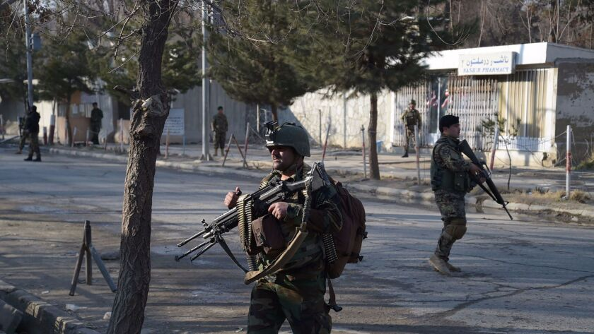 Afghan National Army soldiers keep watch in front of the main gate of a military hospital March 8 in Kabul after a deadly six-hour attack claimed by Islamic State.