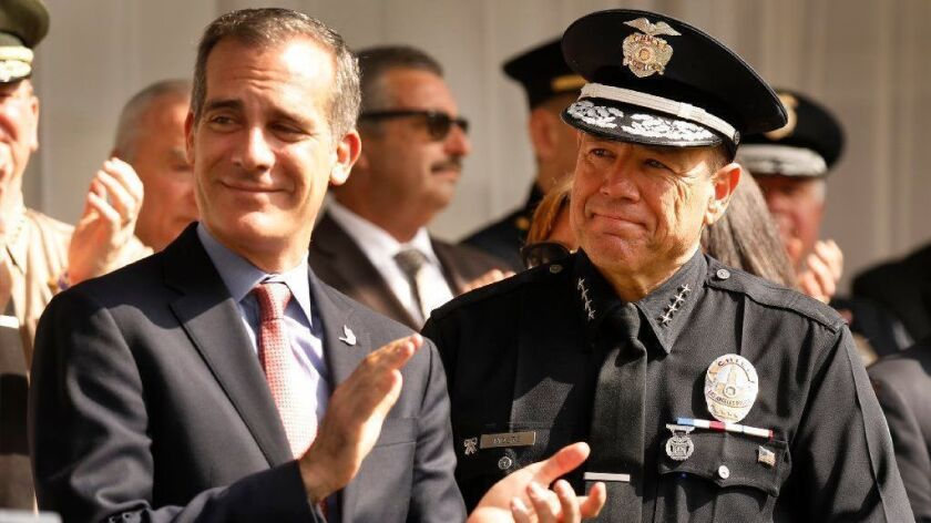 Los Angeles Mayor Eric Garcetti and LAPD Chief Michel Moore at the chief's swearing-in ceremony in June.