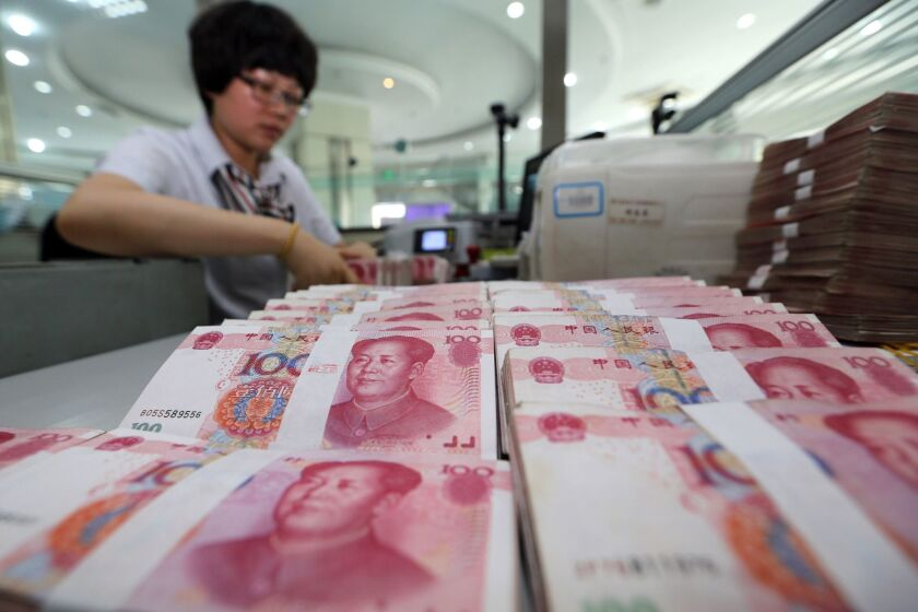 China's central bank devalued the yuan by nearly 2% against the dollar as Beijing seeks to push market reforms and bolster the world's second-largest economy.