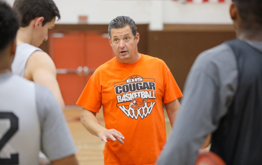 Escondido coach Paul Baldwin (shown at practice) has guided the Cougars to a 28-1 league record the past three seasons.