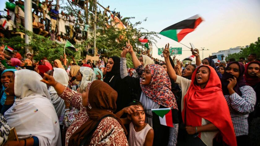 Sudanese protesters rally Friday outside the army headquarters in Khartoum, the capital.