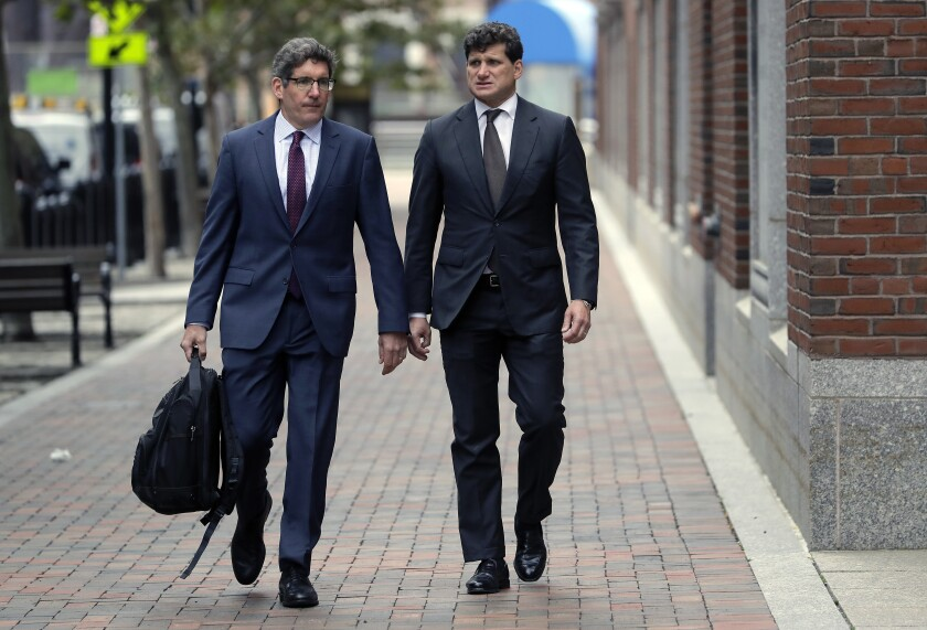 Gordon Caplan, right, arrives at federal court May 21 in Boston. He was sentenced Oct. 3 in the college admissions scandal.