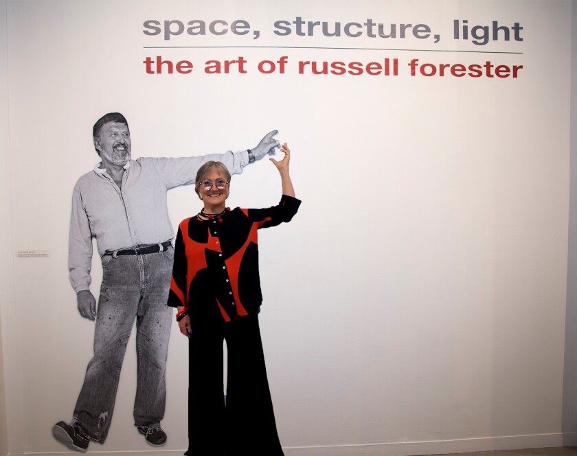 La Jollan Christine Forester at the entrance to her late husband's exhibit at Oceanside Museum of Art