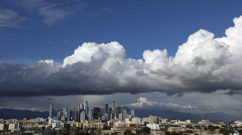 Los Angeles, CA April 5, 2019: Clouds roll across the skyline over downtown Los Angeles on the fir