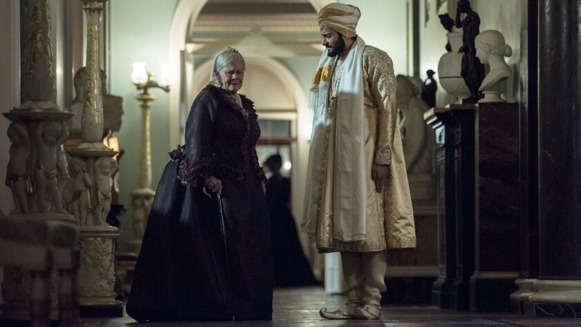"Judi Dench and Ali Fazal in Stephen Frears' ""Victoria & Abdul."""