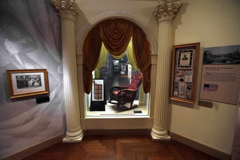 The chair in which President Abraham Lincoln was assassinated on April 14, 1865 is shown on display at the Henry Ford Museum in Dearborn, Mich., March 23, 2015. The Henry Ford Museum is offering a closer glimpse of the pivotal piece of history to mark the assassination's 150th anniversary. The Henr