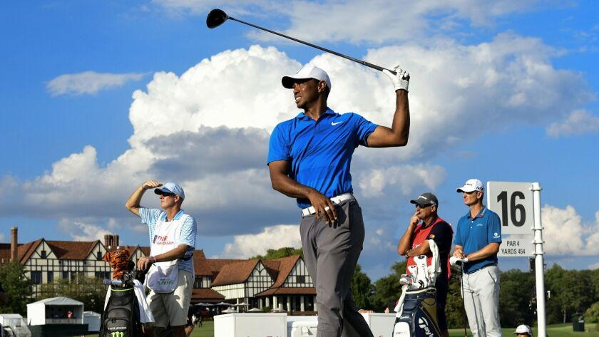 Tiger Woods hits out of the 16th tee box during the third round of the Tour Championship golf tourna