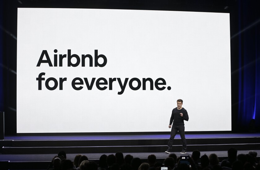 FILE - In this Feb. 22, 2018, file photo, Airbnb co-founder and CEO Brian Chesky speaks during an event in San Francisco. Home-sharing company Airbnb Inc. says it will go public in 2020. It's a long-awaited move for the company, which was founded in 2008 in San Francisco. (AP Photo/Eric Risberg, File)