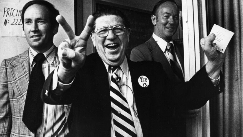Howard Jarvis, chief sponsor of Proposition 13, signals victory as he casts his vote in Los Angeles on June 6, 1978.