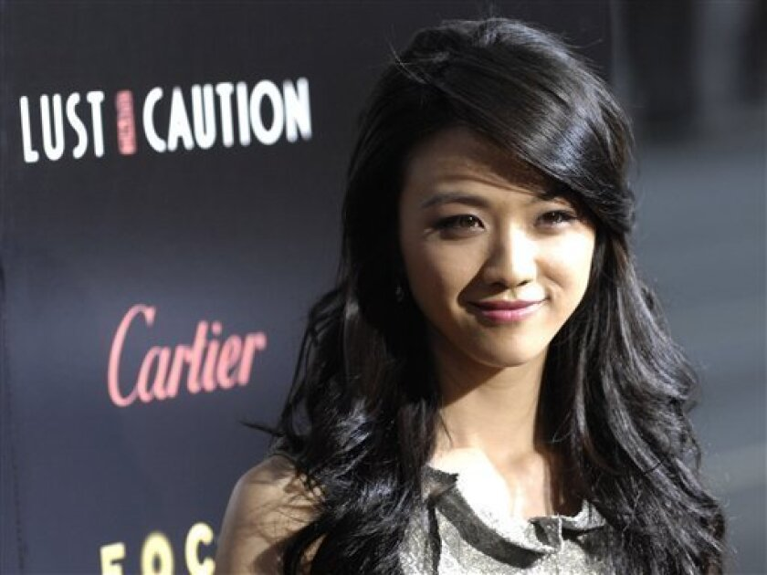 """In this Oct. 3, 2007 file photo, Tang Wei arrives at a screening of the film """"Lust, Caution"""" at the Academy of Motion Picture Arts and Sciences in Beverly Hills, Calif. Tang will co-star with veteran Hong Kong singer Jacky Cheung in the upcoming Chinese-language comedy """"Crossing Hennessy,"""" about the friendship that develops between two shopkeepers who are set up on a date, Hong Kong-based Irresistible Films said Thursday, Feb. 5, 2009. (AP Photo/Chris Pizzello, file)"""