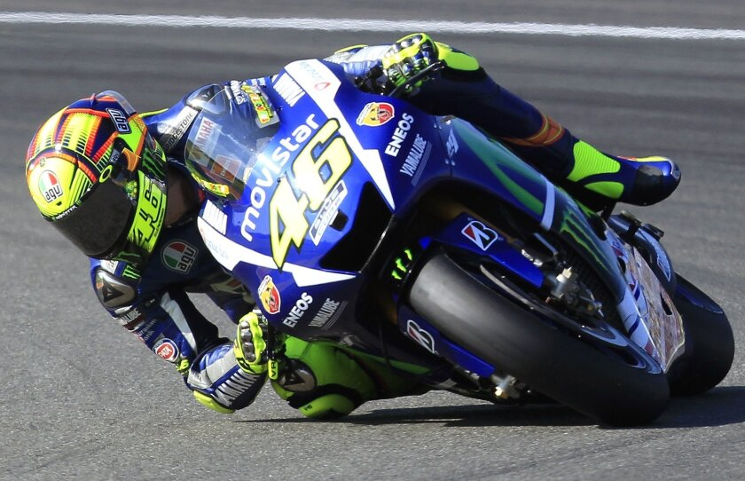 MotoGP rider Valentino Rossi of Italy steers his motorcycle during the Valencia Motorcycle Grand Prix, the last race of the season, at the Ricardo Tormo circuit in Cheste near Valencia, Spain, Sunday, Nov. 8, 2015. (AP Photo/Alberto Saiz)