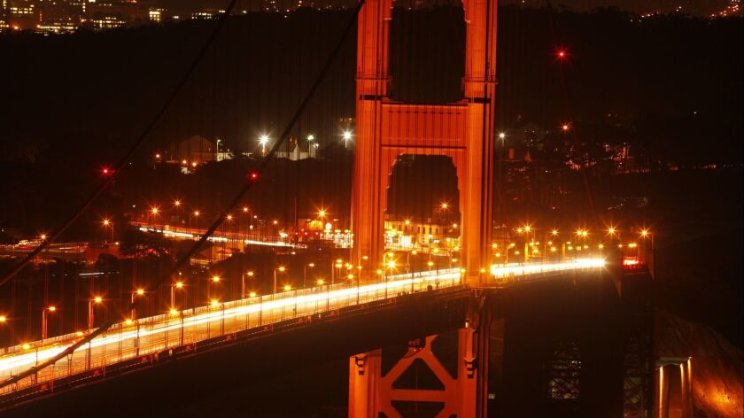 SAN FRANCISCO , CA., June 20, 2013: The Golden Gate Bridge in San Francisco glows after sunset thank