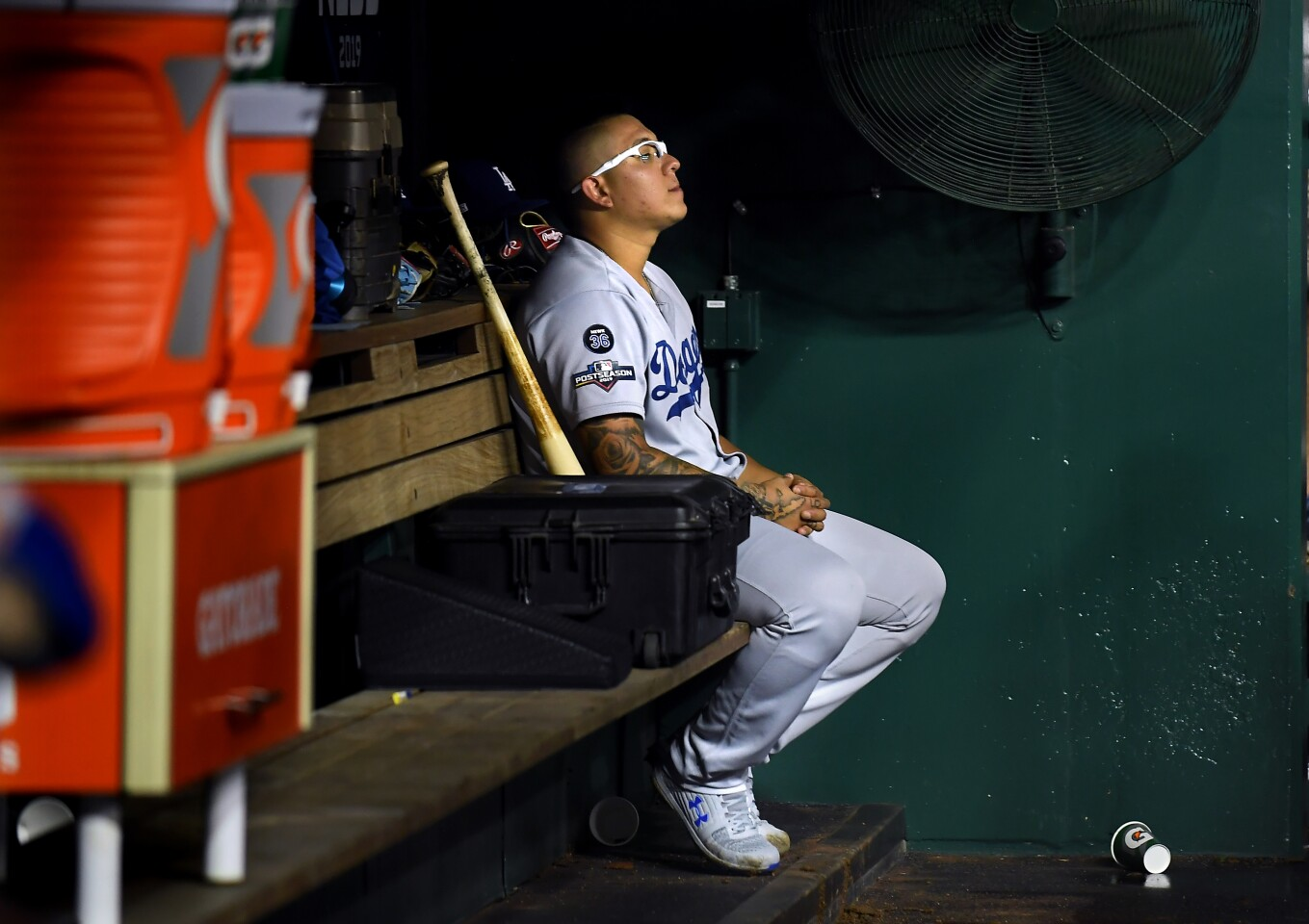 WASHINGTON D.C., OCTOBER 7, 2019-Dodgers relief pitcher Julio Urias sits in the dugout alone after giving up three runs against the Nationals in Game 4 of the NLDS at Nationals Stadium Monday. (Wally Skalij/Los Angeles Times)