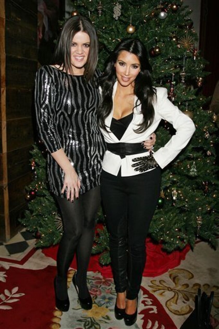 """In this photo provided by Starpix, sisters Khloe, left, and Kim Kardashian, pose for a photo in New York at their Season 4 premiere party, Tuesday, Dec. 8, 2009. Their reality show, """"Keeping Up With the Kardashians"""" can be seen on the E! television network.  (AP Photo/Starpix, Dave Allocca)"""