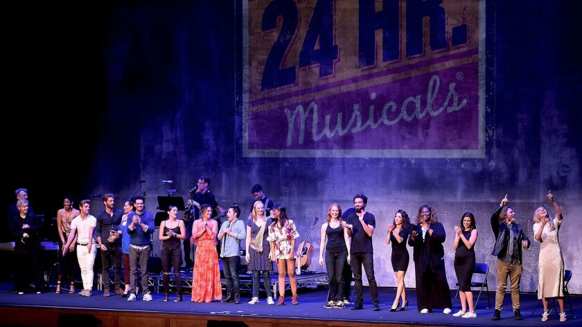 The cast of 24 Hour Musicals: Los Angeles laughs through the curtain call after an evening of wacky performances Monday night in L.A.