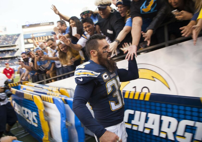 The San Diego Chargers vs. The St. Louis Rams at Qualcomm Stadium. San Diego Chargers free safety Eric Weddle (32) is greeted by fans after the win.