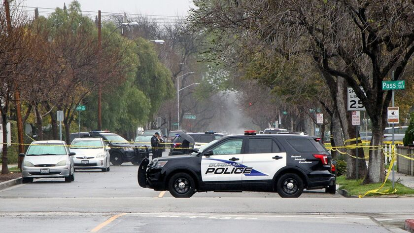 Police vehicles at the scene of a shooting at a Burbank birthday party that left 21-year-old Christian Guevara dead.