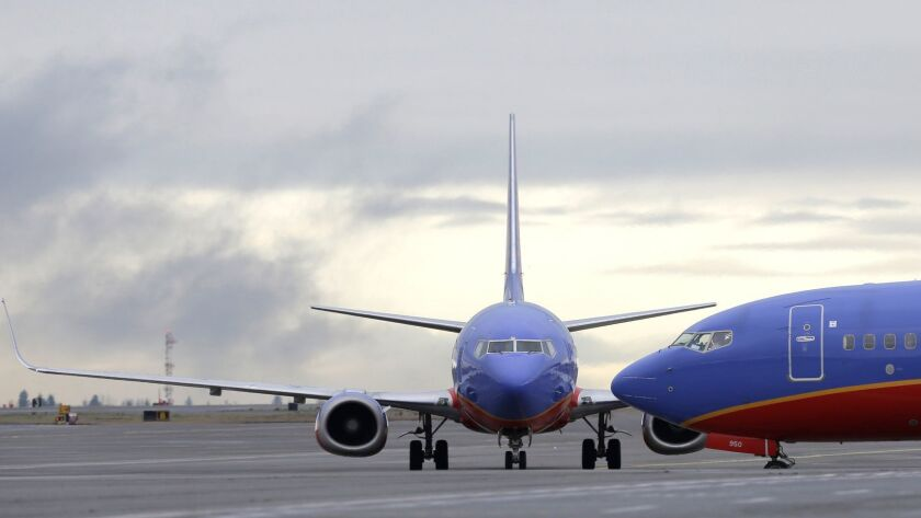 FILE- In this Jan. 26, 2016, file photo, a Southwest Airlines Boeing 737 waits to taxi to a gate to