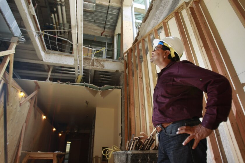 Rajesh Gupta, who recently finished serving as chair of UC San Diego's computer science department, on Thursday surveyed the stairway being constructed so students in the building's basement can more easily access the upper floors.