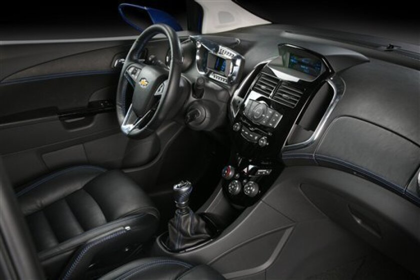 This image provided by General Motors Friday Jan. 8, 2010 shows the interior of the 2011 Chevrolet Aveo RS show car which features a European-inspired hot hatch look designed to appeal to young enthusiasts. As competition heats up in the subcompact car segment, Chevrolet is giving its value-priced Aveo a bolder design and more powerful engine. Chevrolet will introduce the Aveo RS show car at the Detroit auto show next week. (AP Photo/Genreal Motors)