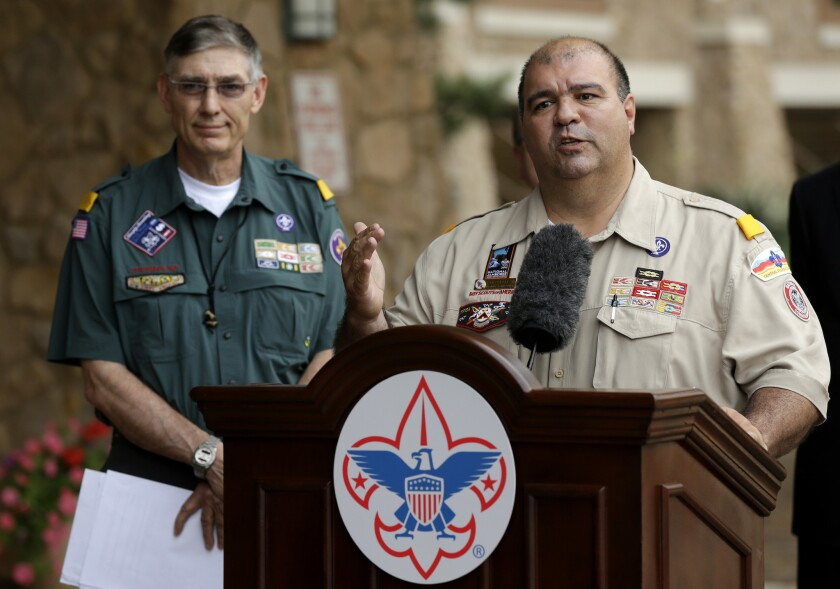 Boy Scouts of America National Commissioner Tico Perez, right, and President Wayne Perry at a news conference last Thursday in Texas where the group announced that openly gay minors would be allowed to become Scouts. A bill approved by the California Senate on Wednesday would deny the Scouts a state tax exemption because the group does not allow gay adults to participate.