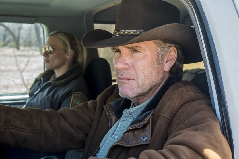 "Robert Taylor as Walt Longmire, with Katee Sackhoff, in ""Longmire."""