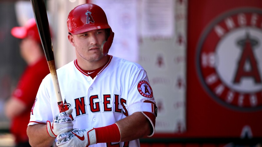 ANGELS, CALIF. -- SUNDAY, JUNE 3, 2018: Angels Mike Trout warms up in the dugout against the Ranger