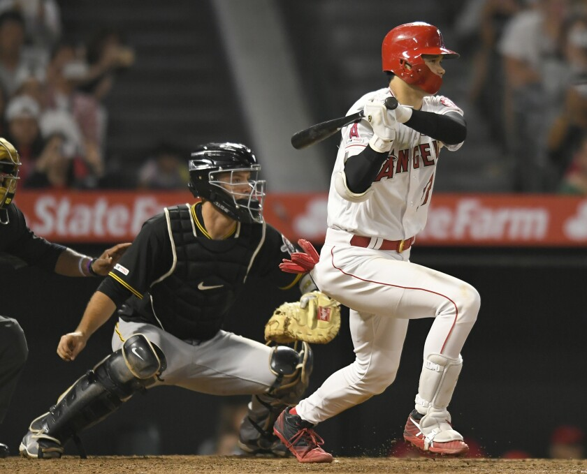 ANAHEIM, CA - AUGUST 13: Shohei Ohtani #17 of the Los Angeles Angels of Anaheim gets a hit while Jacob Stallings #58 of the Pittsburgh Pirates looks on in the ninth inning at Angel Stadium of Anaheim on August 13, 2019 in Anaheim, California. (Photo by John McCoy/Getty Images) ** OUTS - ELSENT, FPG, CM - OUTS * NM, PH, VA if sourced by CT, LA or MoD **