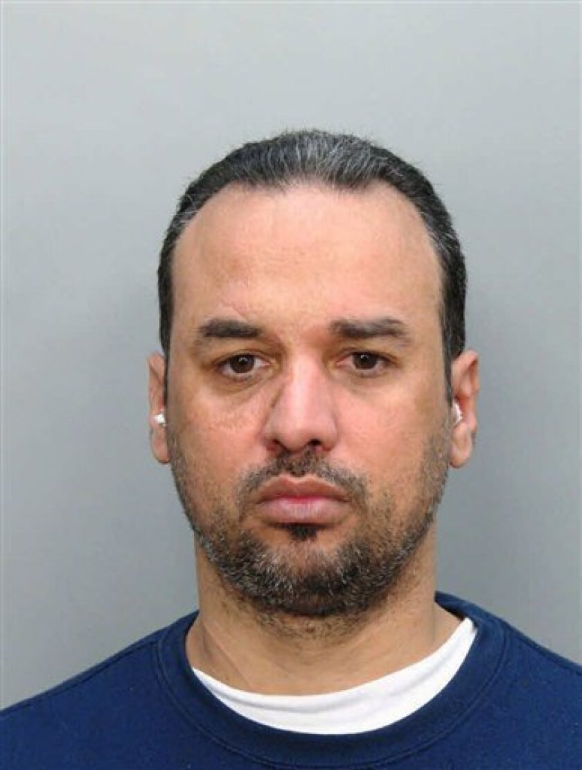 This file photo provided by the Miami Dade Corrections and Rehabilitation Department shows Alberto Morales. Morales who escaped in Texas after stabbing a detective with his eyeglasses was fatally shot early Saturday, Feb. 16, 2013 after refusing to cooperate with officers and lunging at them, polic