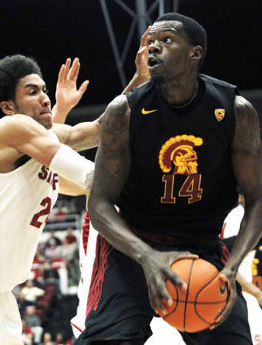 Dewayne Dedmon, right, has been suspended indefinitely from the USC men's basketball team.