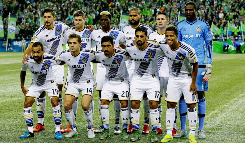 Los Angeles Galaxy players pose for the traditional pre-match team portrait before an MLS soccer western conference knockout round playoff match against the Seattle Sounders, on Oct. 28.