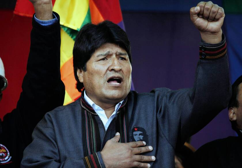 Former Bolivian President Evo Morales sings the national anthem in a file photo.