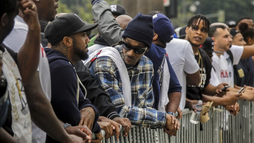 Rapper Snoop Dogg stands outside LAPD headquarters during a peaceful march earlier this month.