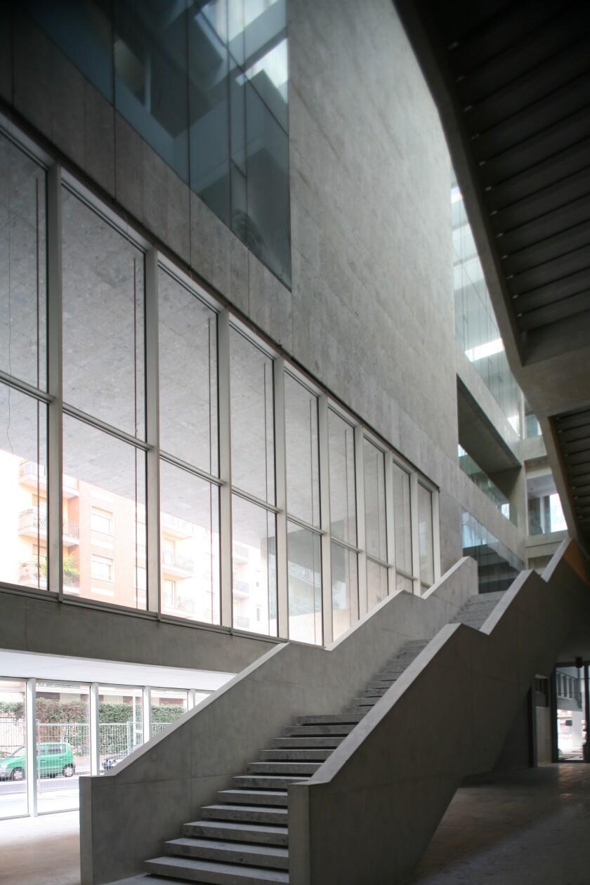 An interior stairwell in Grafton Architects' Universita Luigi Bocconi building in Milan
