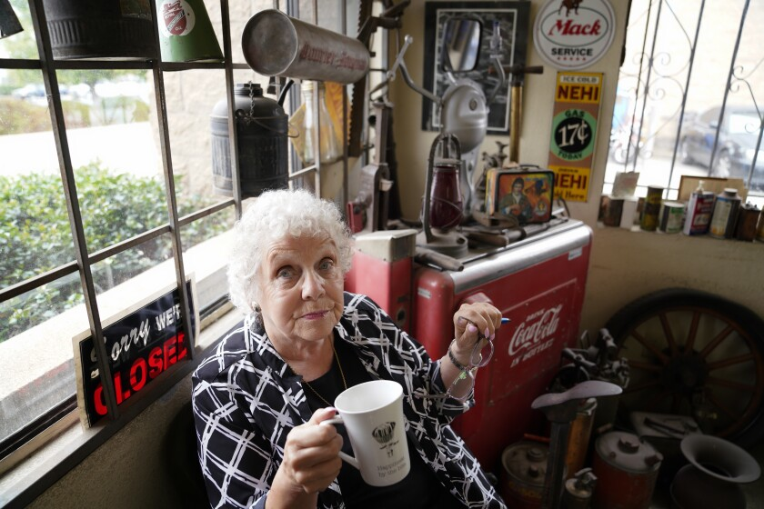 Kathy Piland, 84, takes a coffee break from her office job at West Auto Wreckers in Chula Vista, where she's been working five days a week, with just a couple of breaks, since January 1965.